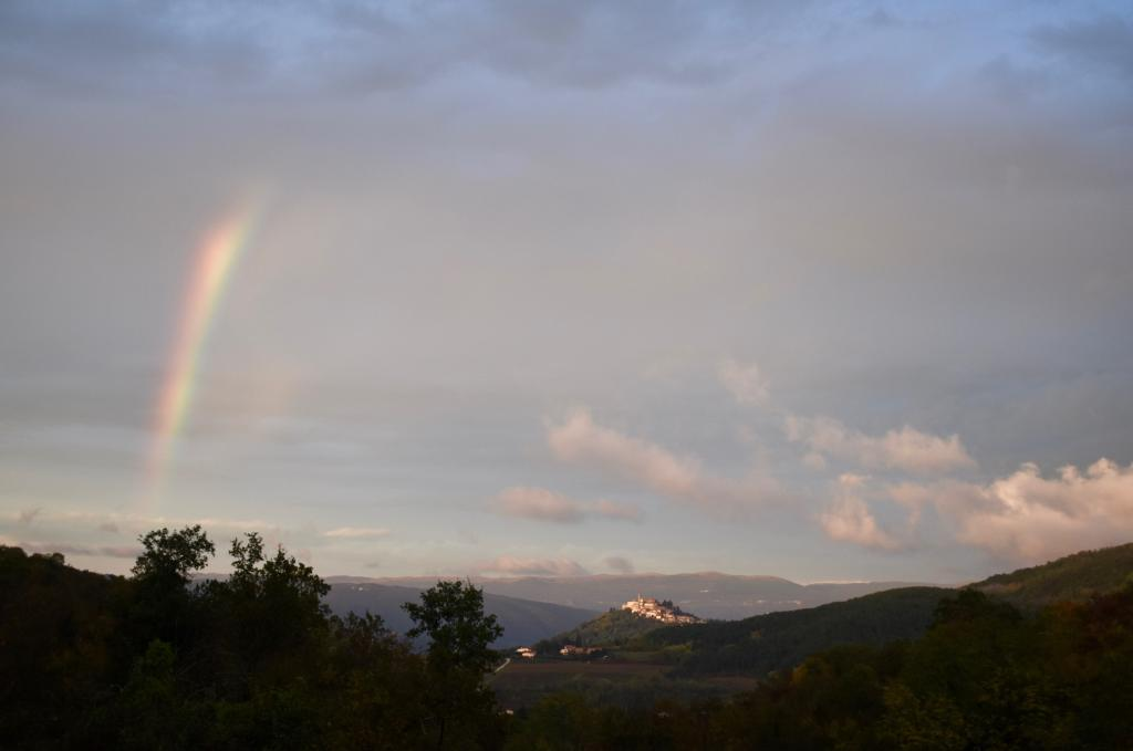 Rainbow and a hilltop town