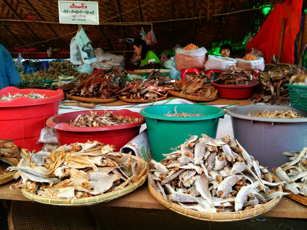 Baskets with dried fish at the market