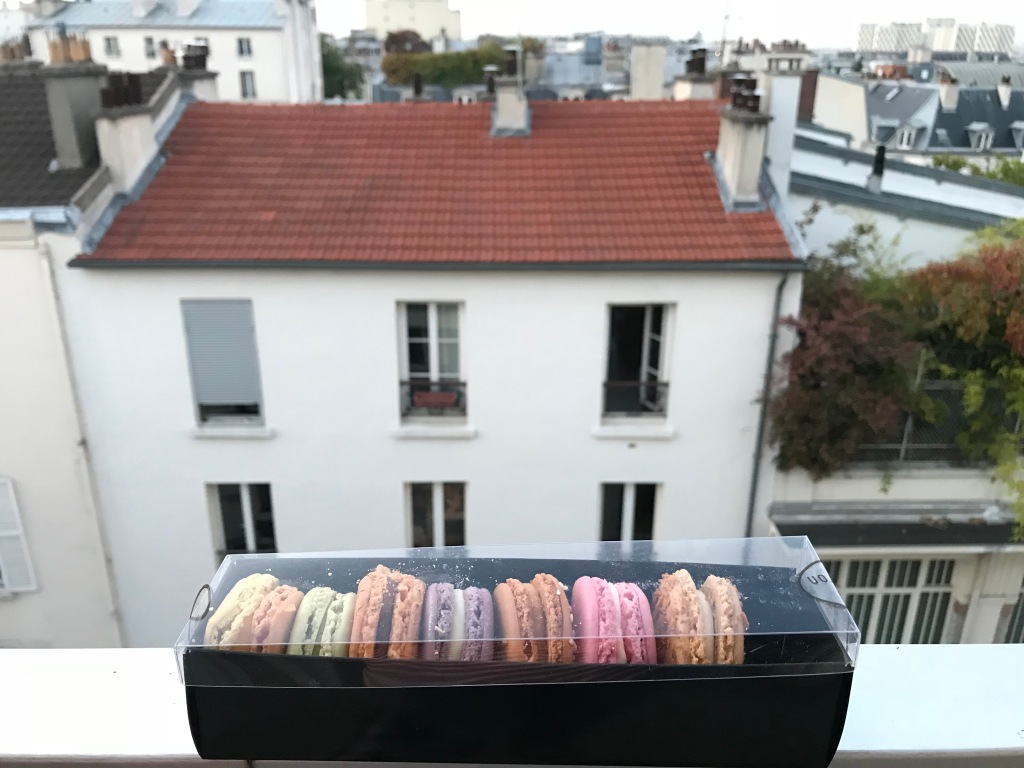 Colourful cookies in a box with a city view