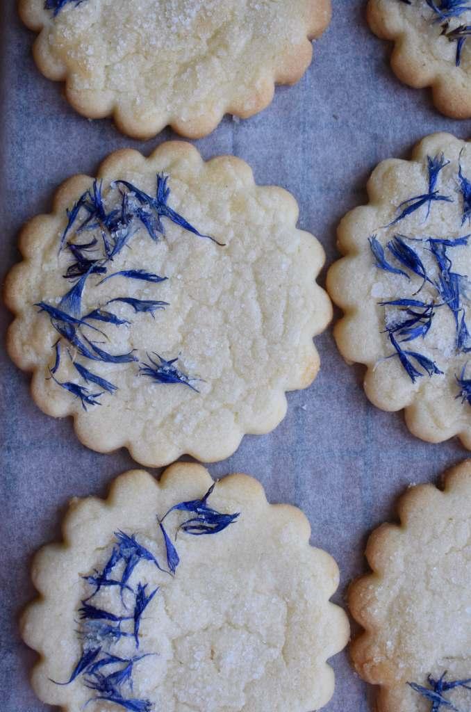 round shortbread biscuits with blue cornflower petals