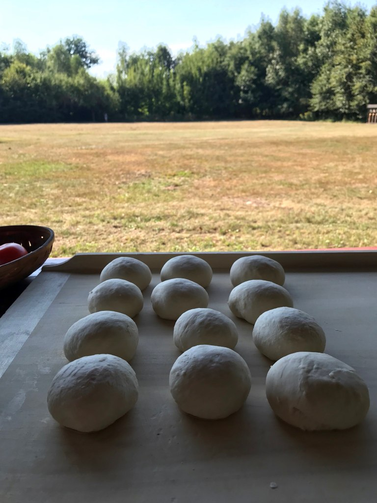 pieces of dough resting on a pastry board outdoors