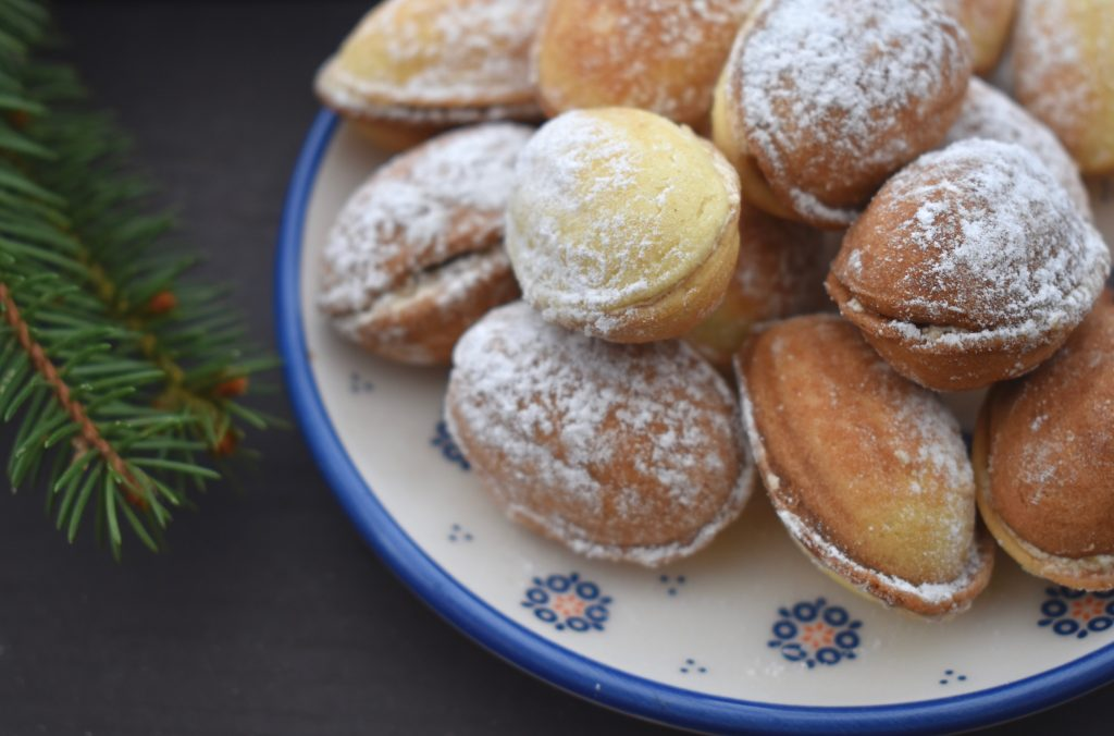walnut shaped homemade cookies sprinkled with icing sugar
